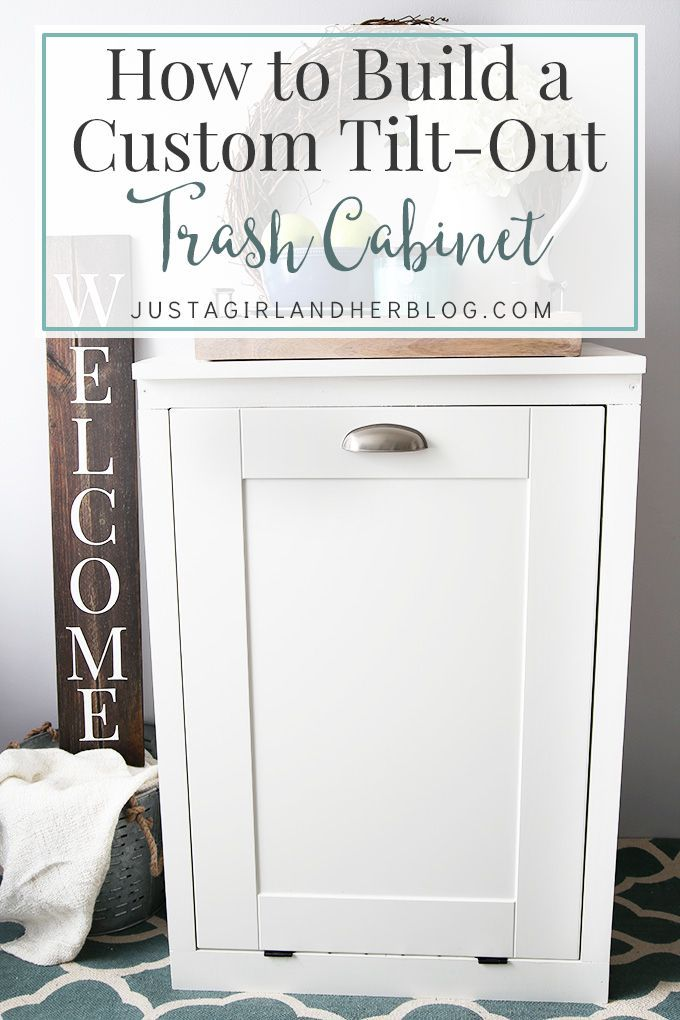 This custom tilt-out trash cabinet is awesome for hiding ugly trash cans and can be customized to match your kitchen! We need to make this for our house! | JustAGirlAndHerBlog.com