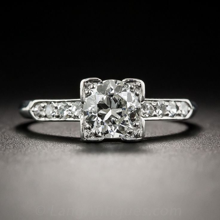 A beautiful bright white and brilliant transitional European-cut diamond, weighing .80 carat, shines almost solo between slender rows of glittering single-cut diamonds in this gorgeous, elegantly understated traditional solitaire engagement ring, hand-fabricated in platinum - circa 1930s-40s. The four-corner setting artfully adds dimension to the perceived outline of the diamond. Sparkle! The soft knife-edge ring shank is currently ring size 6 1/4.