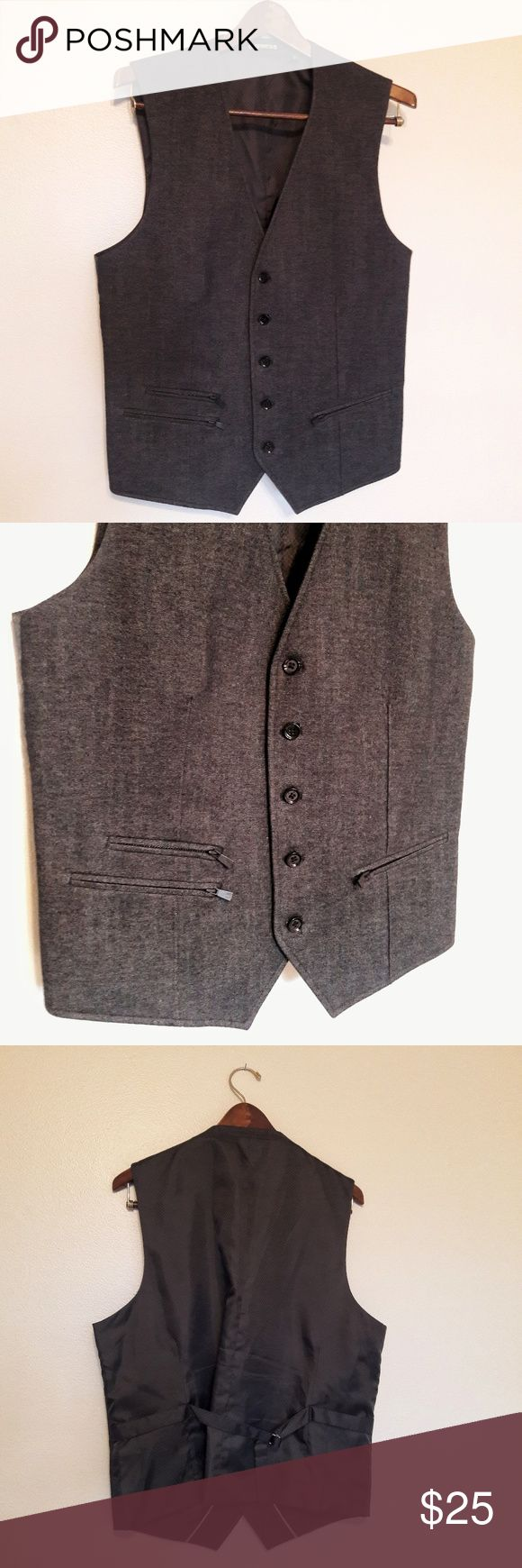 Express Men's Suit Vest Large Men's Express suit vest. Adjustable in the back. Zipper and button detailing in the front as pictured.   52% cotton, 31% polyester, 17% rayon  Material is 80% polyester and 20% rayon. Lining is 100% poly.   Bundle and save! Offers are welcome 💕💕 Express Suits & Blazers Vests