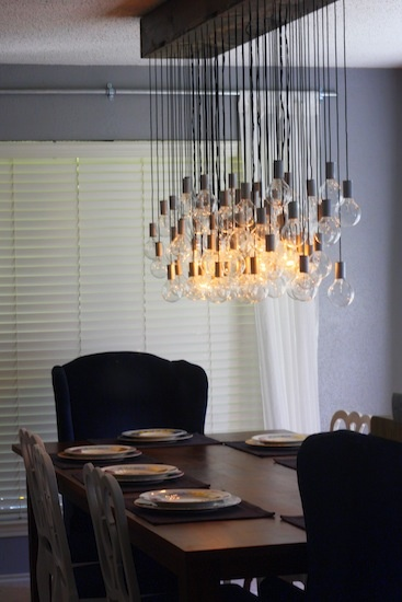 diy dining room light - comes with a tutorial. How about using reclaimed wood, and rethink recycled glassware to surround the 8 working bulbs.