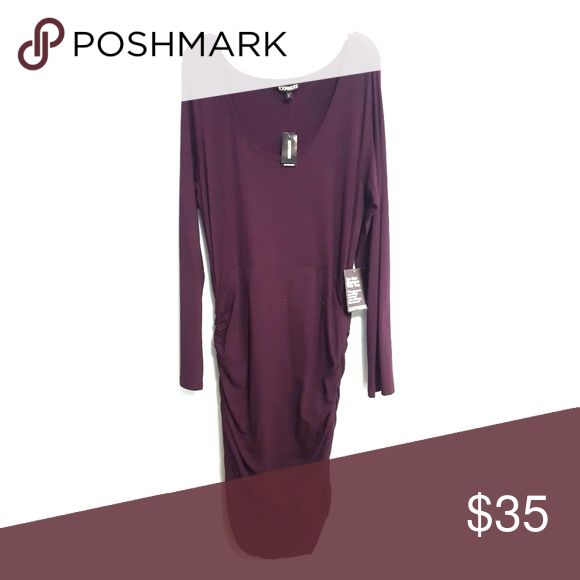 Midi Dark Purple Bodycon Dress Dark plum/purple stretchy dress, rouched sides and long sleeves. Never worn, from Express. All tags still on. Comfy material. Dress falls right over the knees, and fits to your curves. Express Dresses Midi