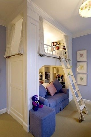 kids reading area with loft bed overhead. Really opens up the room more too by stacking the bed over the couch
