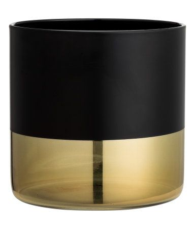 Black/gold-colored. Small color-block vase in painted glass with gold-colored lower section. Diameter 4 1/2 in., height 4 1/2 in.