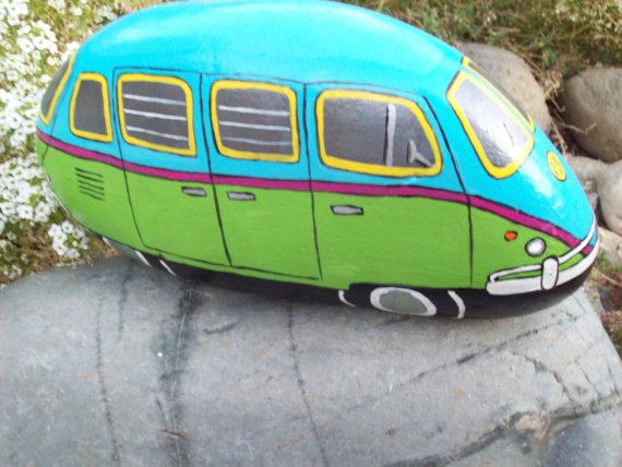VW BUS painted rock (looks more like an Olds Silhouette)