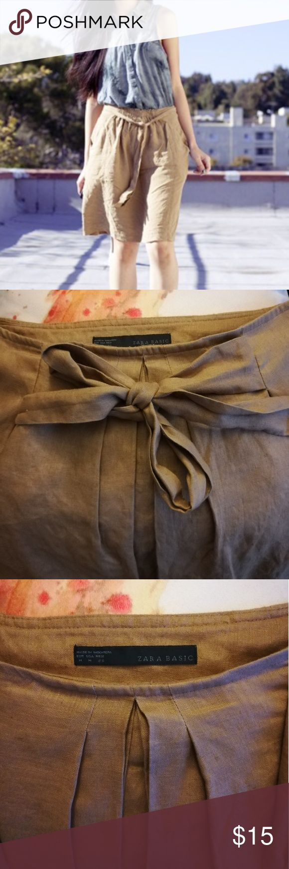 Zara Skirt This preloved Zara linen skirt has a tie front over pleats with a side zip and a slip.  Don't hesitate to ask for any additional information or pics  The last picture is the same skirt I just couldn't find a stock photo in the khaki color. Zara Skirts