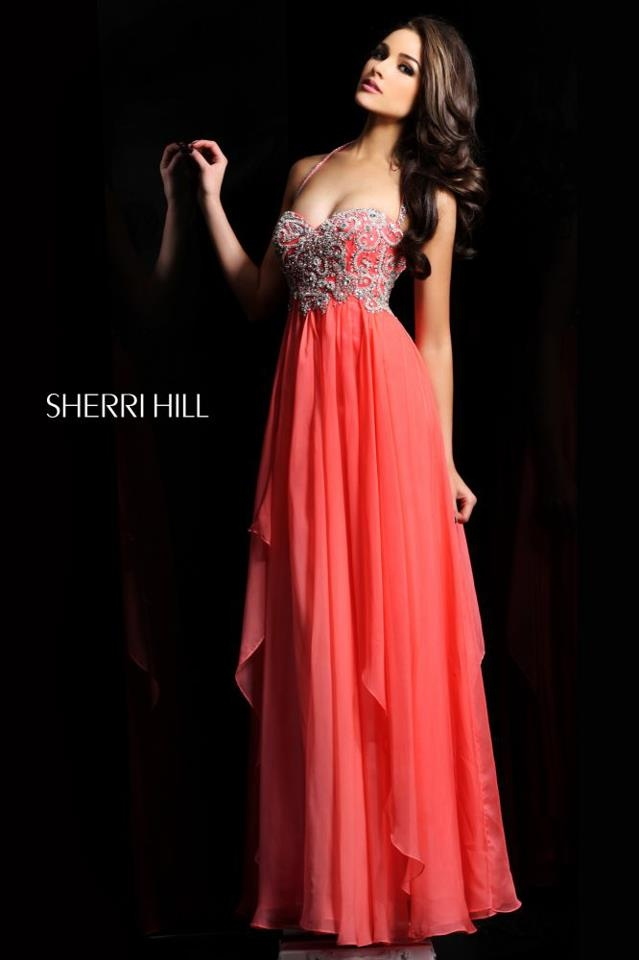 Olivia Culpo flatters her complexion in this flowing salmon dress made by the one and only @Sherri Hill.