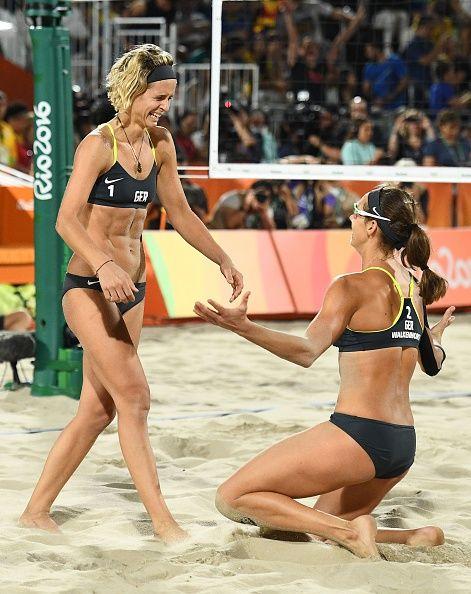 Germany's Laura Ludwig and Germany's Kira Walkenhorst celebrate after winning…