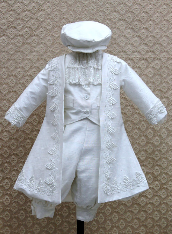 This is a Dupioni Silk Christening Gown Set. Comes along with a single breast vest, a matching neck-tie, Shirt, Jacket and Cap.    *Note: If you want a Larger Size please Inquire.   Colors: Ivory, White     Sizes: 6m, 12m, 18m, 24m.     Price: ($350.00)