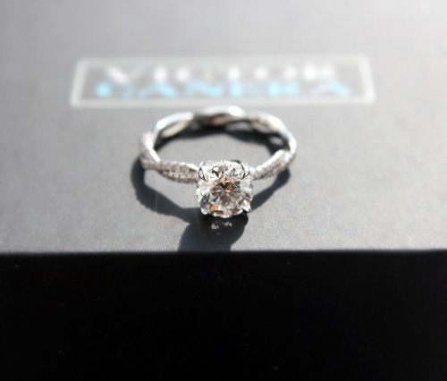 Custom diamond engagement ring with braided shank. Not for me, but cool use of braiding!!