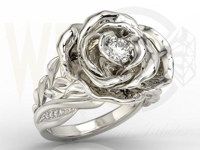 Pierścioneki w kształcie róży z białego złota z diamentami / Rose-shaped ring made from white gold with a diamonds / 5830 PLN #gold #jewelry #diamonds #ring #jewellery #biżuteria