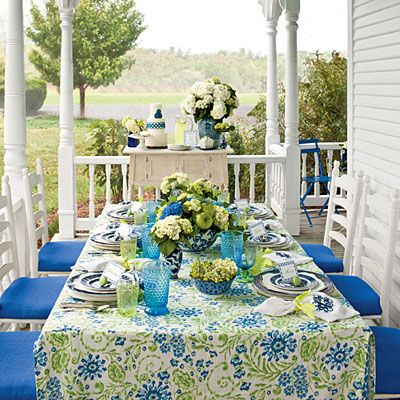 Blue and White Table Ideas | For Jennifer Carroll, entertaining on your front porch is the epitome of Spring in the South. Use blue-and-white-china on your table for a for fun yet timeless feel. | SouthernLiving.com