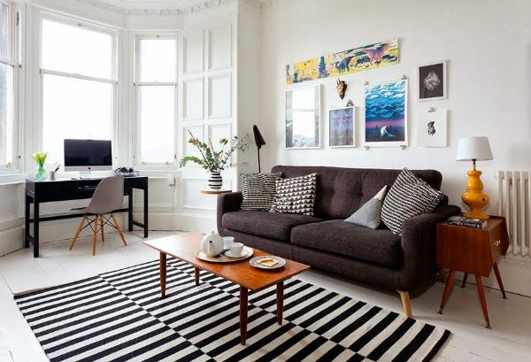 Colorful vintage-inspired living room | striped black and white rug