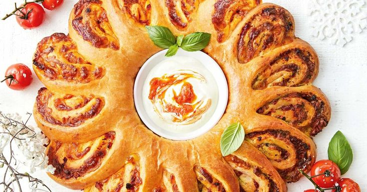 A cheesy, pesto pull-apart bread wreath, complete with a chilli mayo dip.