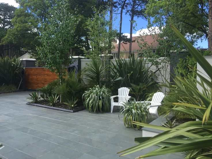 Create a sleek modern outdoor space with Brazilian grey #paving https://mrs-stone-store.com/brazilian-grey-slate-paving-slabs/