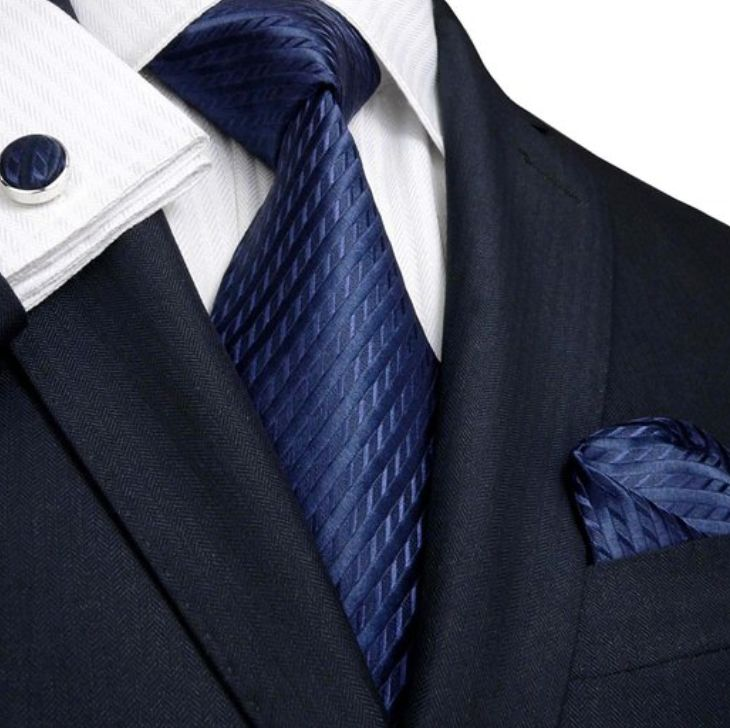 Landisun Navy Blue Silk Tie Set, Handkerchief & Cufflinks £19.99 Landisun ties are carefully handmade using 100% pure woven silk. When you wear a Landisun Tie Set you are guaranteed to make a statement without saying a word.