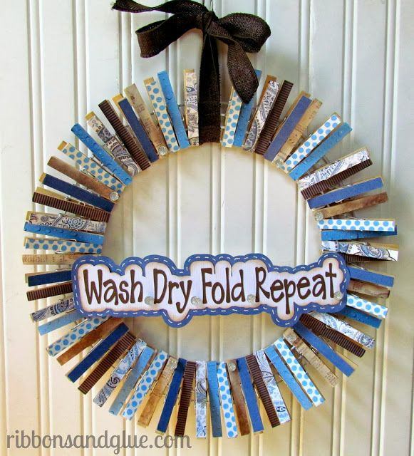 Mod Podge paper on to clothespins to make a Laundry Room Wreath.