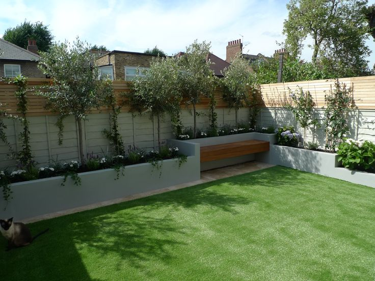 I like the combination of concrete planters up against the fence with the wooden bench sitting area. Bamboo would work well in the planter.