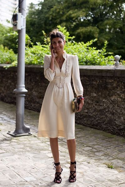 Giovanna Battaglia in a white dress & strappy black sandals #style #fashion #streetstyle