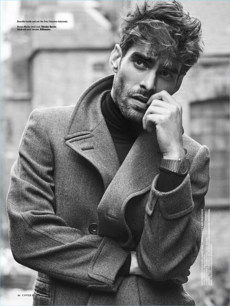 Spanish model Jon Kortajarena dons a Chester Barrie coat with a Billionaire sweater.