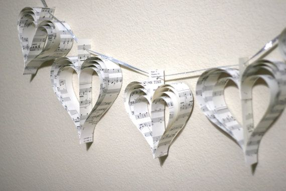 paper heart garland from Etsy. I want this for my bedroom, but it would be great for a wedding, too!