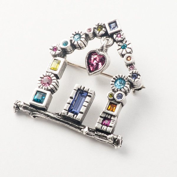 Home Is Where The Heart Is Brooch Pin from Patricia Locke. Cast in pewter then plated in sterling silver. Accented with Austrian crystals. A portion of the proceeds from the sale of each Home is Where The Heart Is pin are donated to Habitat For Humanity. Patricia Locke Jewelry is handmade in Mundelein, Illinois.