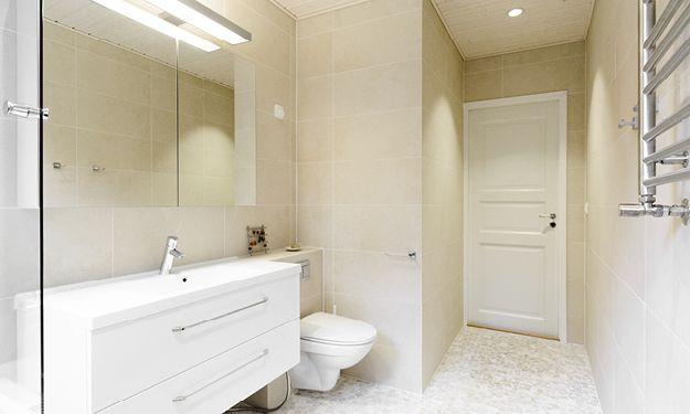 Kylpyhuone, n. 6 m². Seinäwc- kotelon sisällä on matala wc-elementti, jolloin kotelo saatiin altaan kanssa samaan tasoon.