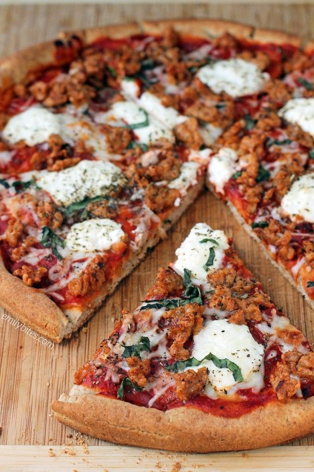 There's no need to order in or go out for pizza when you can make this delicious lightened up Sausage and Ricotta Pizza at home in about 20 minutes! Each slice is just 193 calories or 6 Weight Watchers SmartPoints. www.emilybites.com