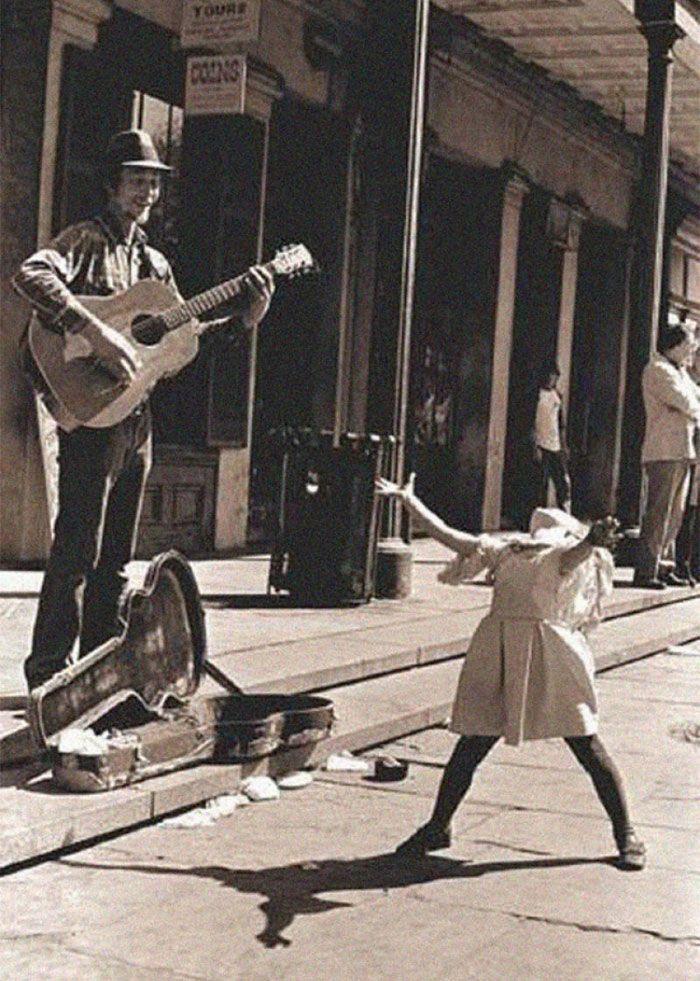 A Street Musician And A Little Girl