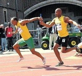 Asafa Powell passing off the baton to Michael Frater at the Penn Relays - 4/30/2011