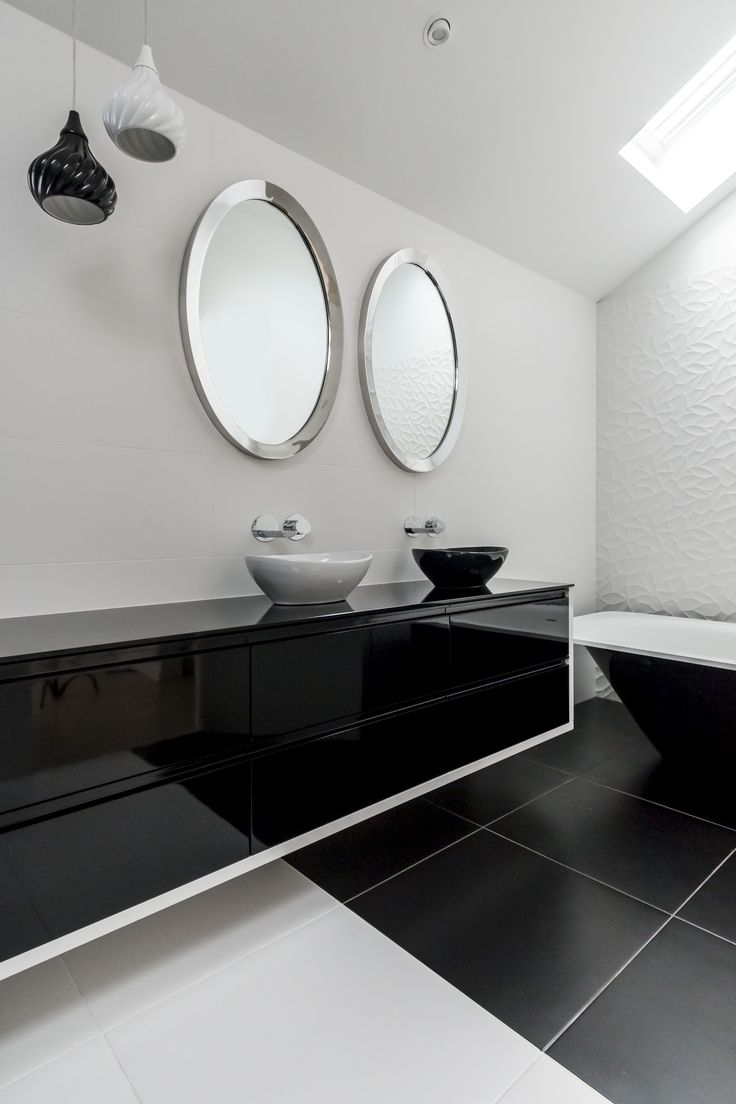 Being monochromatic there is the chance of the bathroom becoming bland and sterile monotonous but there is a textural contrast provided by the tiles and the black gloss and plays well with matte white. Combine this with clean and well-defined lines, lacquered surfaces, a floating vanity and minimal decor, and you have the perfect minimalist bathroom. The addition of a standalone bath complements the rest of the bathroom is a stylish bonus. The freedom and trust that this client gave me…