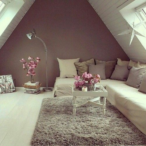 Mauve, blush, cream, grey. Angled couch, grey fuzzy rug, couch pillows, flowers.