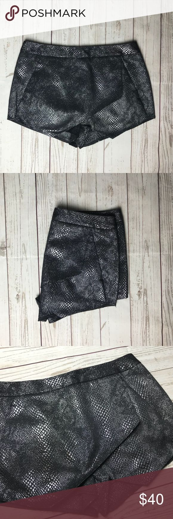 Women's Express Shorts Black and silver metallic shorts. NWT. Size 4. Express Shorts Skorts
