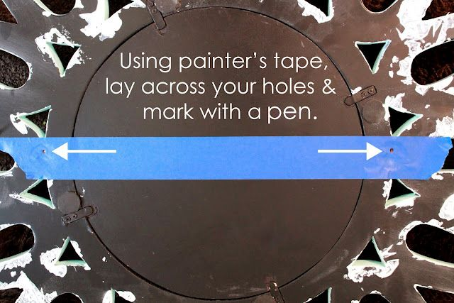 Use painters tape to mark the holes of the items that require two nails to hang, then place the tape on the wall and drill your holes...that just makes too much sense!!!