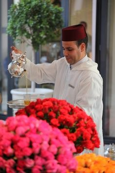 Abdelaziz is serving Moroccan tea at the lobby with beautiful roses by his side