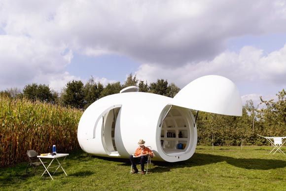dmvA designed a mobile living and working unit. It has all the practical comforts of a caravan, the difference is that it looks like a sculpture. Closed the blob is like a huge pebble, or even an egg. With its nose opened it has more of a funny looking space-ship. OWI // Office for Word and Image