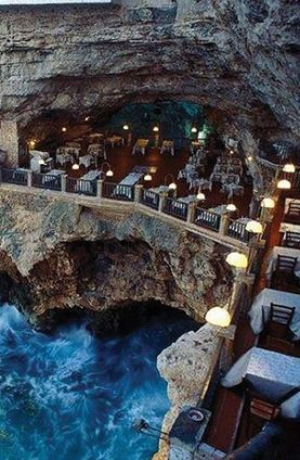 Eat dinner in a seaside cave at Grotta Palazzese in Italy.