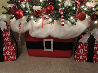 Red Storage Tub decorated and used as a basket to hold the Christmas Tree