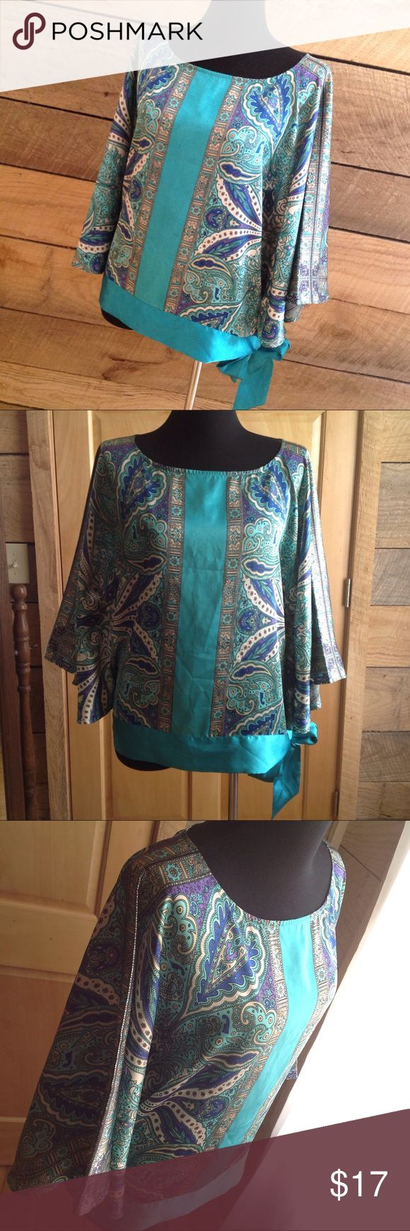 Lane Bryant Blue Paisley Blouse 18 20 Loose Tie Lane Bryant Tie Waist Loose Batwing Blouse  Woman plus Size 18 - 20 Polyester Turquoise Blue Paisley Scarf Shirt   inches Armpit to Armpit:31 Shoulder Seam to Hem: 26 Shoulder Seam to Cuff: 13 The needle holes from sewing bow shut are visible when bow is untied. See last photo for detail Lane Bryant Blouse Turquoise Paisley Batwing Tie Waist Shirt Lane Bryant Tops Blouses