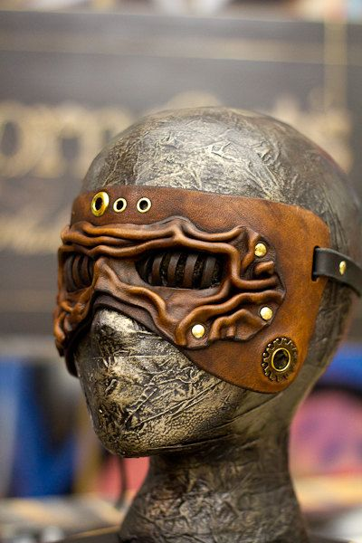 Eye Cage from Osborne Arts Sculpted Leather Masks  http://www.etsy.com/listing/88501801/brown-steampunk-eye-cage-handmade