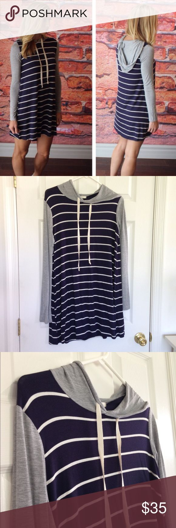 """Navy Striped Hoodie Dress So cute and comfy! Stretchy. 96% rayon and 4% spandex. Measurement laying flat: bust: 20"""" length: 34"""". No stains or holes. Mon Ami Dresses Midi"""