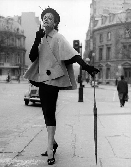 vintage swing jacket, pencil skirt and cocktail hat. Great pose with umbrella.