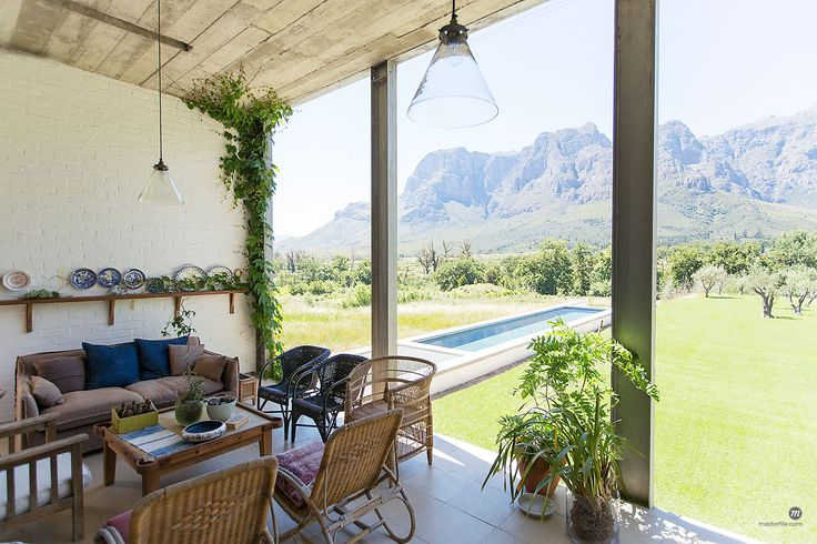 Living room overlooking backyard and landscape. 6113-07731099 © Masterfile.