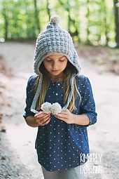 Girls of all ages will be warm for the holidays with this festive hood! The chunky yarn works up quick, and the simple texture adds a fashionable look that you can enjoy for years to come.