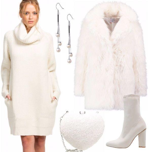 Il colore del ghiaccio per un outfit in realtà caldo e avvolgente: abito 100% cashmere, dalla linea morbida e collo alto molto ampio, cappottino in ecopelliccia. Stivaletti ecru, cuore-pochette brillante e orecchini di perle per un tocco di brillantezza.
