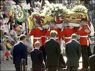 August 31, 1997: Diana, Princess of Wales in killed in a car accident in France. In this photo Prince Charles, Prince Harry, Diana's brother Charles Spencer and Prince William look on as Diana's casket is carried past them.