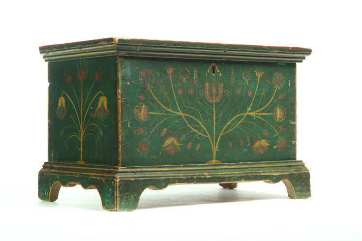 """FINE DECORATED MINIATURE BLANKET CHEST - Attributed to western Virginia, 2nd quarter-19th century, poplar. Dovetailed case on bracket feet & retaining its original stylized flower decoration in red & gold, against a green ground.  11.25""""h. 17.5""""w. 9.75""""d. Attribution on this chest is based on an inscribed chest by the same hand. Research has identified the inscribed name as Granville H. Pool of Grayson County, Virginia."""