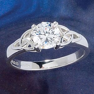 CZ Trinity Ring  Cubic zirconia, the diamond-bright, diamond-clear cultured gemstone, ignites in the light in this trinity-knot, representing pure love, in a setting of polished sterling silver. 2 1/2 ct. Crafted in Ireland. Whole sizes 5-10.  ****  Item #: P11829  Price: $79.95