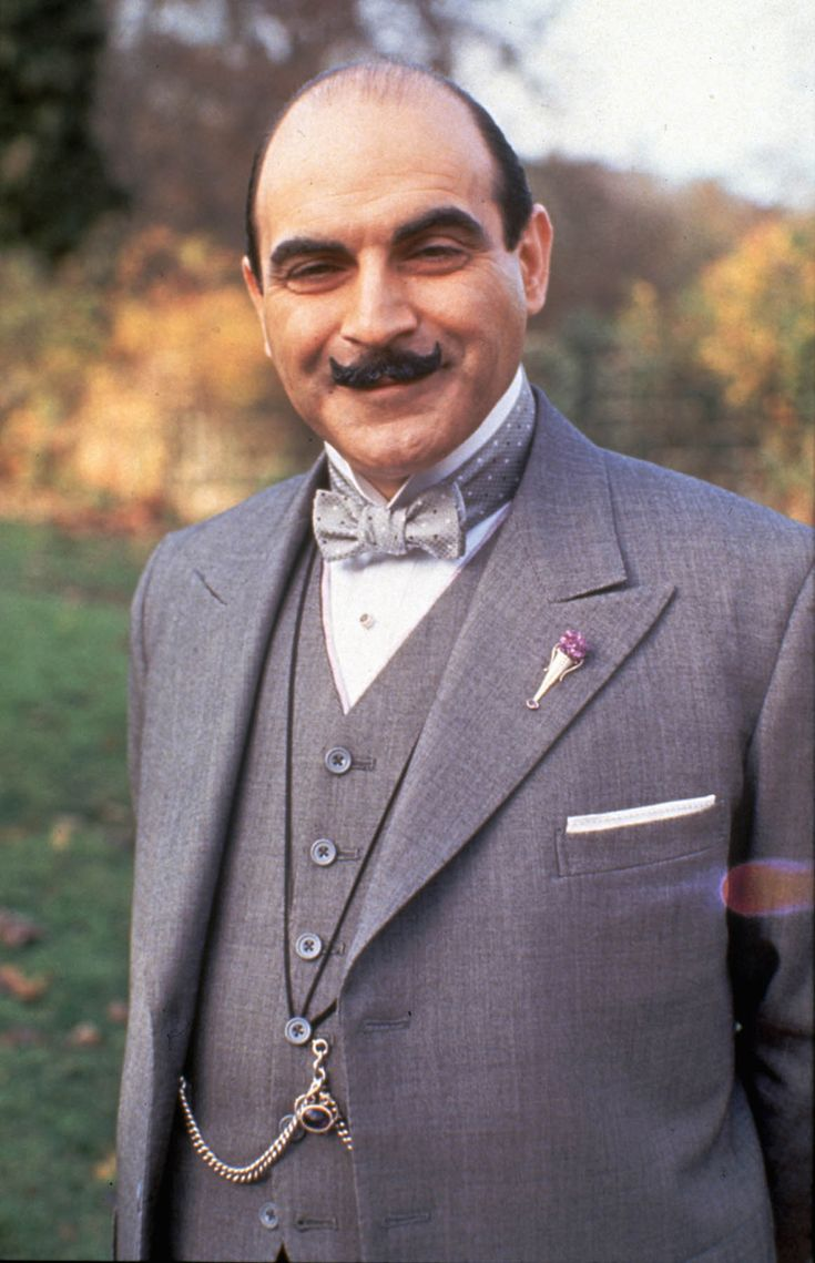 Is the character of Hercule Poirot's famous flower vase lapel pin vintage? Did most men of the time wear one, or is it just another aspect of his eccentric character?