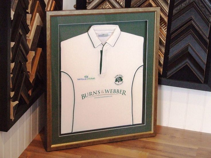 Cricket Shirt framed by this seasons sponsors, Burns & Webber Estate Agents, to match the company colours, gold and green.