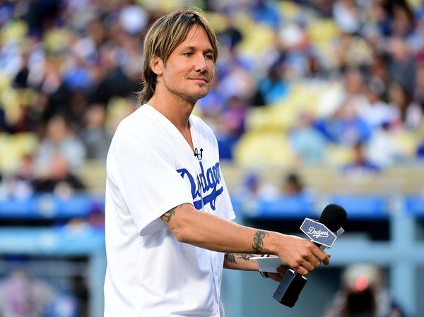 Keith Urban Photos - Singer Keith Urban prepares to announce the starting lineup for the Los Angeles Dodgers before the game against the New York Mets at Dodger Stadium on May 09, 2016 in Los Angeles, California. - New York Mets v Los Angeles Dodgers